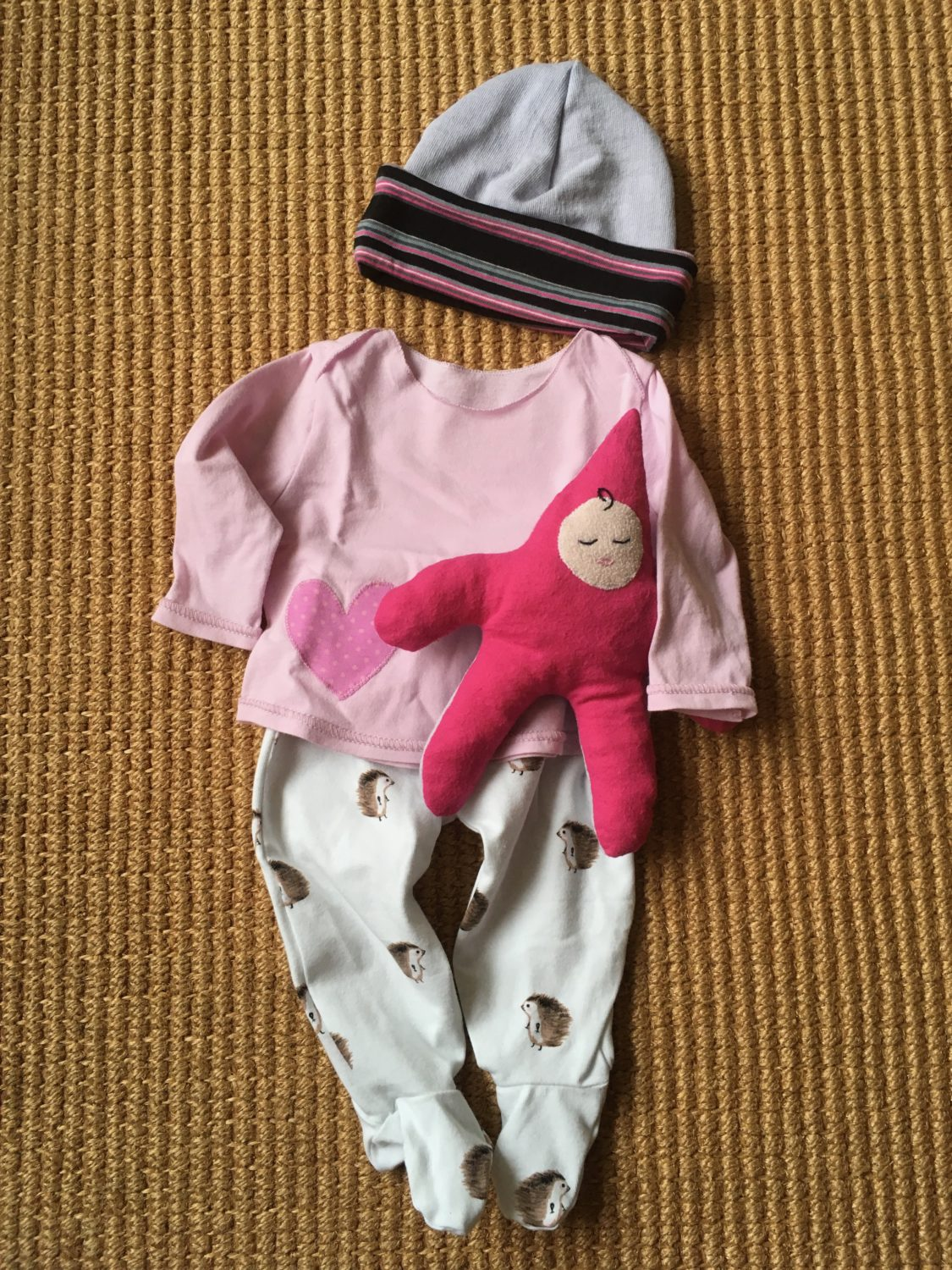 Two new homemade baby outfits